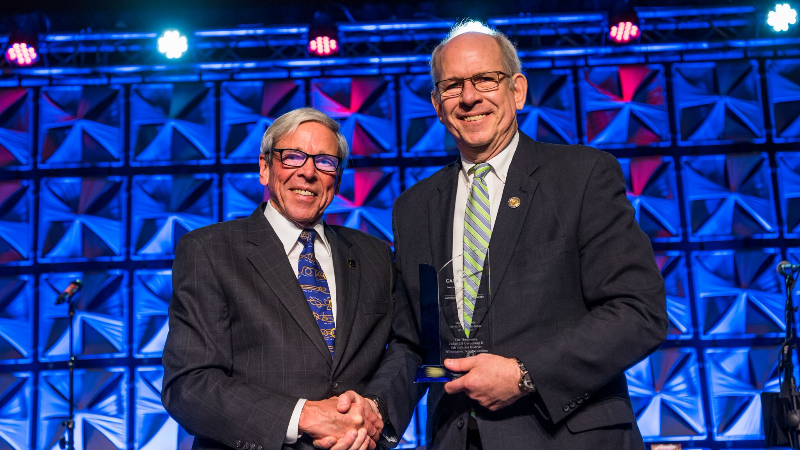 CASA founder The Honorable David W Soukup - left - presented the 2018 National CASA Association Award of Excellence for Judge of the Year to The Honorable JH Corpening II