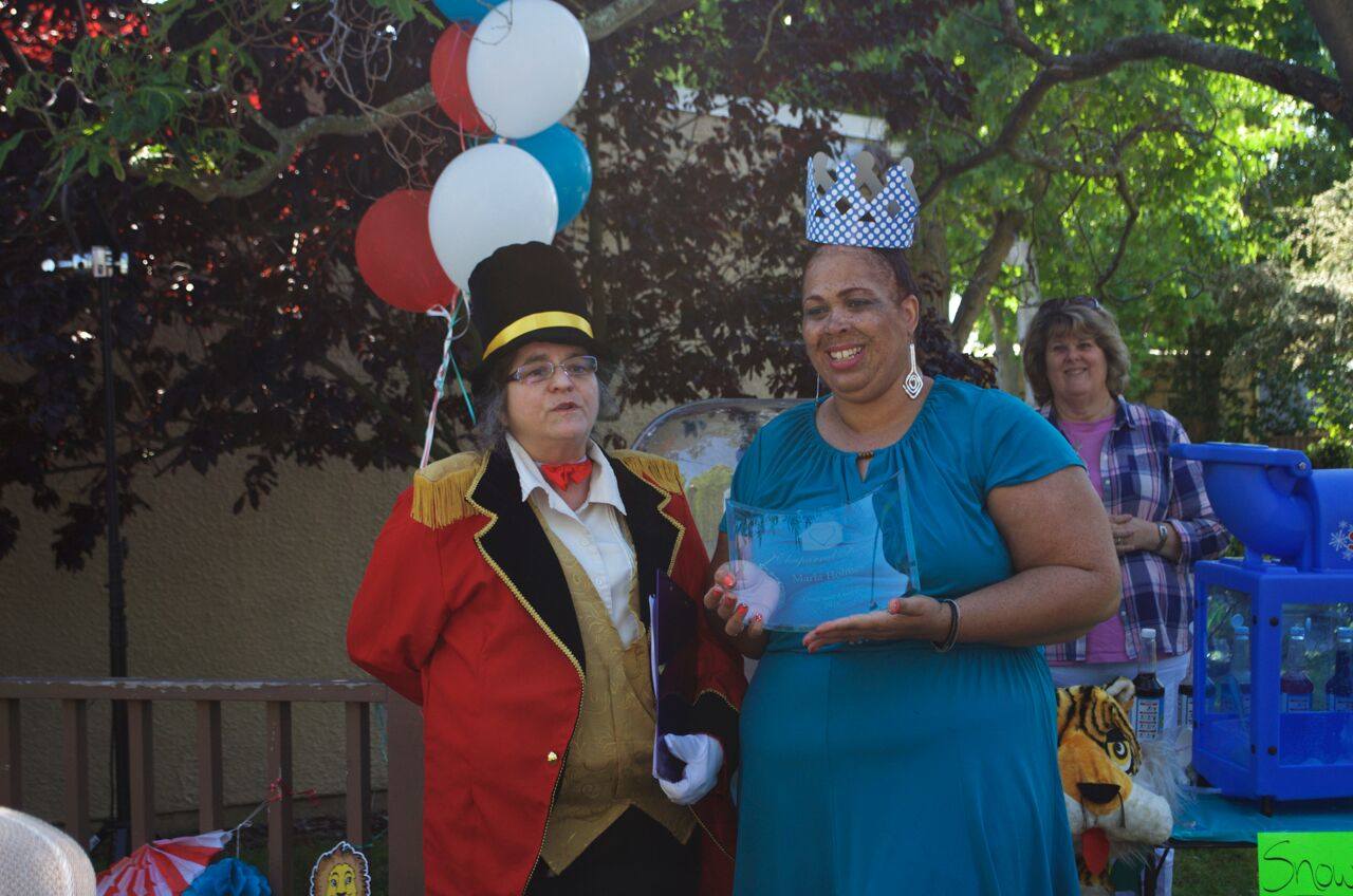Marla Holmes accepts her award