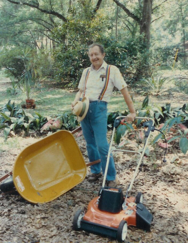 Bill Partington with  Wheelbarrow and lawn mower.png