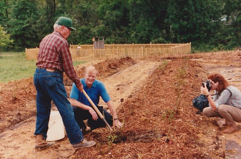 Gene-Strowd-and-Ed-Norfleet-planting-Gene-s-roses-in-the-rose-garden.jpg